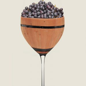Decorative wooden wine glass filled with ripe grapes
