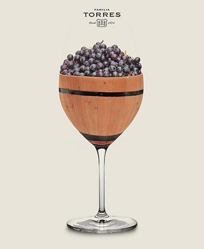 Decorative wooden wine goblet filled with ripe grapes